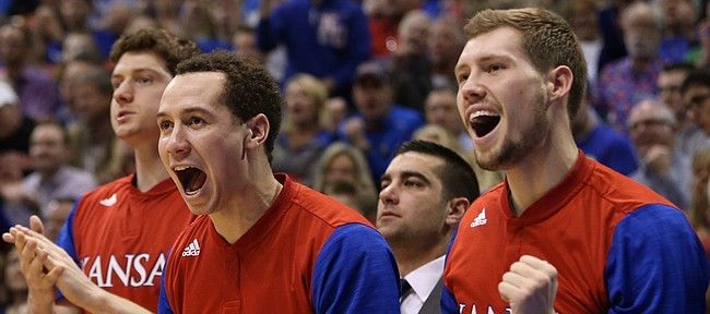 Kansas players Evan Manning, second from right, and Tyler Self celebrate a bucket by Landen Lucas during the second half, Monday, Feb. 15, 2016 at Allen Fieldhouse.