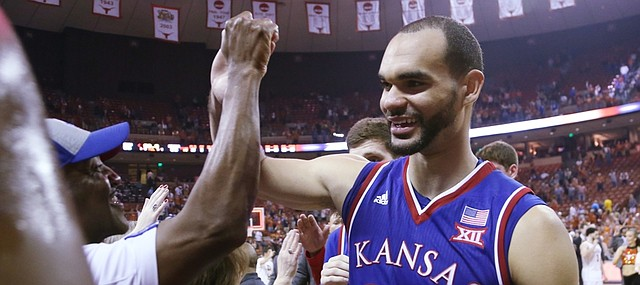 Kansas forward Perry Ellis greets fans as he exits the court after an 86-56 win over the Longhorns Monday, Feb. 29, 2016 at the Frank Erwin Center in Austin, Texas.