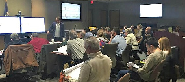 Josh Shelton, a principal with architecture firm el dorado inc., presents the latest designs for the East Ninth project to the East Ninth Citizens Advisory Committee on Wednesday, March 2, 2016.