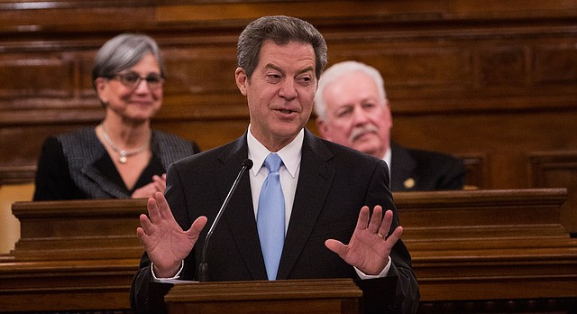 Kansas Gov. Sam Brownback addresses legislators Tuesday, Jan. 12, 2016, in his State of the State address.