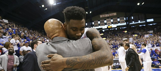Kansas forward Jamari Traylor (31) hugs assistant coach Fred Quartelbaum following the JayhawksÕ 85-78 win over the Cyclones.