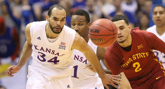 Kansas forward Perry Ellis (34) chases down a loose ball with Iowa State forward Abdel Nader (2) and teammate Wayne Selden Jr. during the first half on Saturday, March 5, 2016 at Allen Fieldhouse.