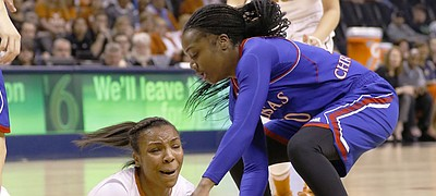 Texas guard Brianna Taylor, left, and Kansas guard Jayde Christopher vie for a loose ball during the first half of an NCAA college basketball game in the Big 12 Conference women's tournament in Oklahoma City, Saturday, March 5, 2016.