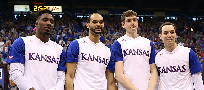 The Kansas seniors from left, Jamari Traylor, Perry Ellis, Hunter Mickelson and Evan Manning are pictured together during a pregame ceremony, Saturday, March 5, 2016 at Allen Fieldhouse.