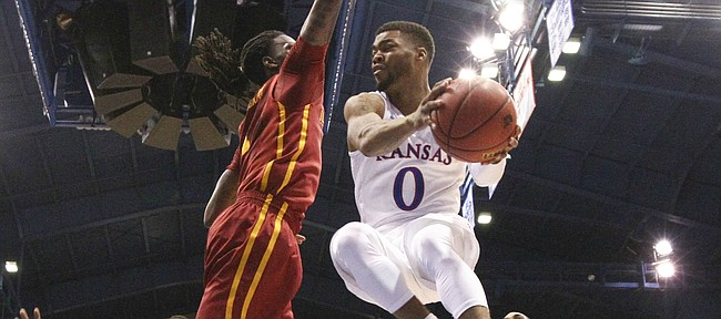 Kansas guard Frank Mason III (0) elevates to throw a pass around Iowa State forward Jameel McKay (1) during the first half, Saturday, March 5, 2016 at Allen Fieldhouse.