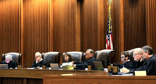 In this Monday, Dec. 14, 2015 file photo, Kansas Supreme Court Justices prepare to hear arguments during a session in Topeka, Kan. (AP Photo/Orlin Wagner, File)