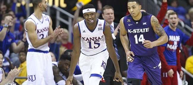 Kansas forward Carlton Bragg Jr. (15) wags his tongue next to Kansas State guard Justin Edwards (14) after hitting a three from the corner during the second half, Thursday, March 10, 2016 at Sprint Center in Kansas City, Mo.