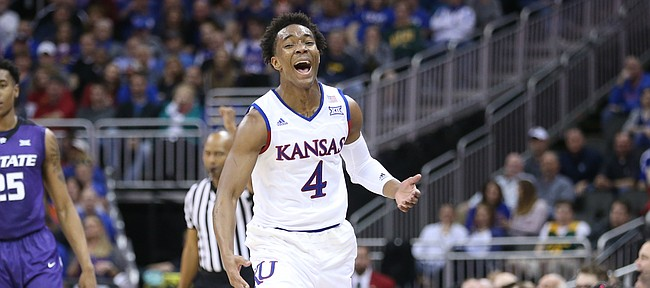 Kansas guard Devonte' Graham (4) reacts to being called for a foul after stripping the ball from Kansas State forward Wesley Iwundu (25) during the first half, Thursday, March 10, 2016 at Sprint Center in Kansas City, Mo.