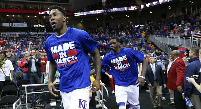 Kansas forward Jamari Traylor, forward Cheick Diallo and the rest of the Jayhawks take the court for warmups, Thursday, March 10, 2016 at Sprint Center in Kansas City, Mo.