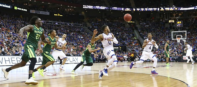 The Jayhawks scramble to get the ball in as it is inbounded to Kansas guard Devonte' Graham (4) with 20 seconds remaining in regulation Friday, March 11, 2016 at Sprint Center in Kansas City, Mo.