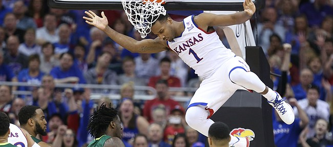 Kansas guard Wayne Selden Jr. (1) comes down after going baseline for a dunk during the second half, Friday, March 11, 2016 at Sprint Center in Kansas City, Mo.