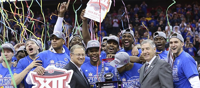 The Kansas Jayhawks celebrate with the Big 12 Tournament trophy following their 81-71 win over West Virginia, Saturday, March 12, 2016 at Sprint Center in Kansas City, Mo.