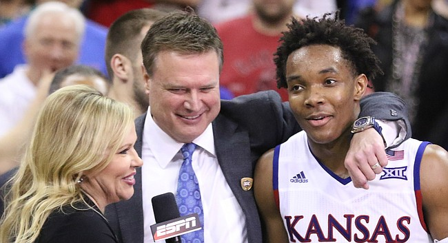 Kansas head coach Bill Self puts his arm around guard Devonte' Graham (4) during the postgame interview with Holly Rowe of ESPN.