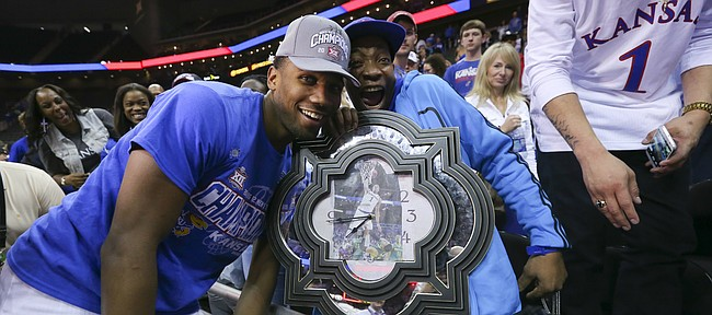 Kansas guard Wayne Selden Jr. (1) celebrates with his uncle Anthony and a big clock featuring a picture of Selden and his dunk from the semifinal game as the Jayhawks celebrate following their 81-71 win over West Virginia, Saturday, March 12, 2016 at Sprint Center in Kansas City, Mo.