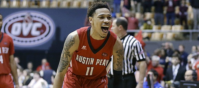 Austin Peay guard Khalil Davis (11) celebrates as Austin Peay beats UT Martin in an NCAA college basketball game at the championship of the Ohio Valley Conference tournament Saturday, March 5, 2016, in Nashville, Tenn. Austin Peay won 83-73. (AP Photo/Mark Humphrey)