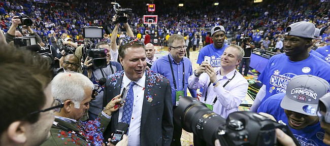 Kansas head coach Bill Self reacts after being doused with confetti by his players as the Jayhawks celebrate following their 81-71 win over West Virginia, Saturday, March 12, 2016 at Sprint Center in Kansas City, Mo.