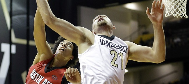Vanderbilt forward Samir Sehic (21) and Austin Peay guard Jared Savage (2) reach for a rebound in the first half of an NCAA college basketball game Friday, Nov. 13, 2015, in Nashville, Tenn. (AP Photo/Mark Humphrey)