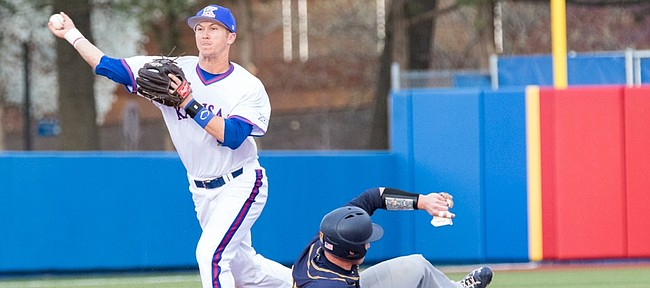 Kansas shortstop Matt McLaughlin makes a throw to first after getting the out at second base on Murray State's Kipp Moore during the Jayhawks' game against Murray State on Tuesday afternoon at Hoglund Ballpark.