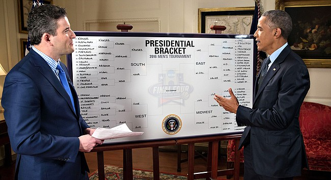 President Barack Obama makes his picks for the 2016 NCAA Men's Basketball Tournament as part of a segment with ESPN's Andy Katz, left.