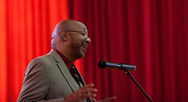 """In this file photo, Pulitzer Prize-winning columnist Leonard Pitts Jr. of the Miami Herald smiles as he speaks to those attending his lecture """"In the Measure of a Man,"""" on Tuesday, June 14, 2011 at Liberty Memorial Central Middle School."""