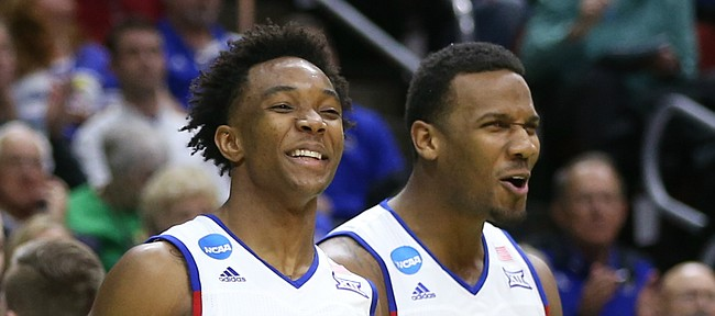 Kansas guard Devonte' Graham (4) and guard Wayne Selden Jr. (1) celebrate a bucket by teammate Sviatoslav Mykhailiuk during the second half, Thursday, March 17, 2016 at Wells Fargo Arena in Des Moines, Iowa.
