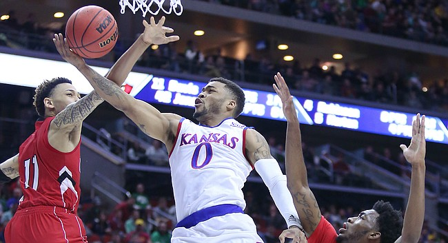 Kansas guard Frank Mason III gets fouled on a drive to the basket in a first-round NCAA tournament game against the Austin Peay Governors Thursday, March 17, 2016 at Wells Fargo Arena in Des Moines, IA.