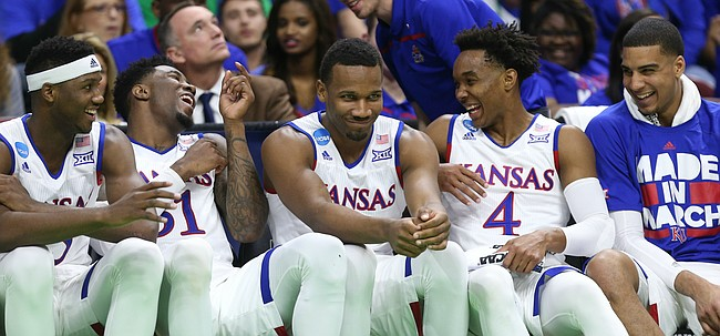 Players on the Kansas bench have a laugh with the game locked up late in the second half, Thursday, March 17, 2016 at Wells Fargo Arena in Des Moines, Iowa.