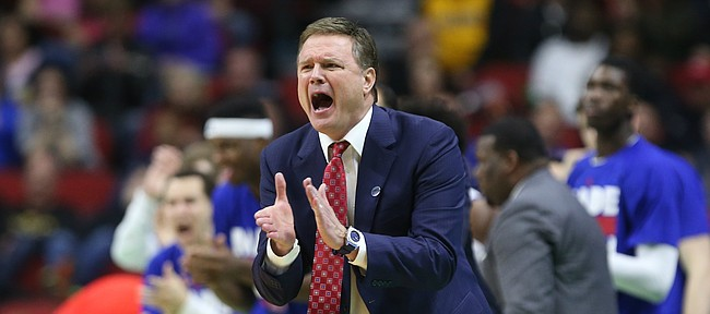 Kansas head coach Bill Self applauds the Jayhawks as they widen their lead during the second half on Saturday, March 19, 2016 at Wells Fargo Arena in Des Moines.