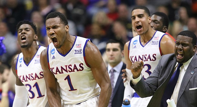 Kansas guard Wayne Selden Jr. (1), Jamari Traylor (31), Landen Lucas and assistant coach Jerrance Howard celebrate a three from teammate Perry Ellis during the first half against UConn on Saturday, March 19, 2016 at Wells Fargo Arena in Des Moines.