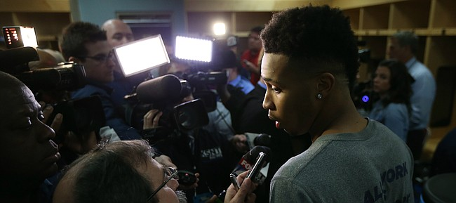 Connecticut guard Jalen Adams (2) talks with media members during a day of press conferences and interviews, Friday, March 18, 2016 at Wells Fargo Arena in Des Moines.