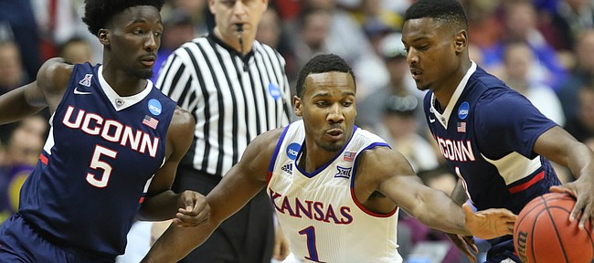 Kansas guard Wayne Selden Jr. (1) eyes the ball as he looks for a steal from Connecticut guard Sterling Gibbs (4) during the first half on Saturday, March 19, 2016 at Wells Fargo Arena in Des Moines. At left is Connecticut guard Daniel Hamilton (5).