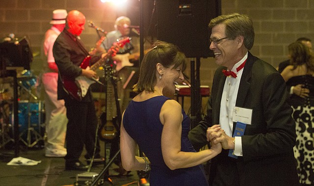 Dale Denning and Kristen Harms show off their dance moves while Billy Ebeling and the Late for Dinner Band provide music at the Hearts of Gold Ball, held May 10, 2014, at the Lawrence Journal-World press building, 608 Massachusetts St. The ball, which is held every two years, serves as a fundraiser for Lawrence Memorial Hospital.