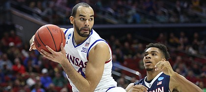 Kansas forward Perry Ellis (34) catches a pass in the paint before Connecticut forward Shonn Miller (32) during the first half on Saturday, March 19, 2016 at Wells Fargo Arena in Des Moines.
