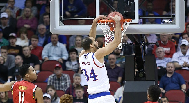 Kansas forward Perry Ellis puts down a dunk in the first-half of the Jayhawks game against the Maryland Terrapins Thursday, March 24, 2016 in an NCAA Sweet Sixteen matchup at KFC YUM! Center in Louisville, KY.