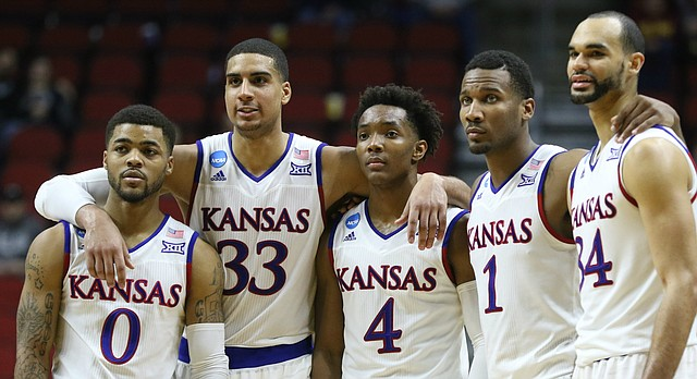 The Kansas starters, Frank Mason III, Landen Lucas, Devonte Graham, Wayne Selden Jr. and Perry Ellis stand arm-in-arm late in the second half as they watch a pair of UConn free throws with the game wrapped up, Saturday, March 19, 2016 at Wells Fargo Arena in Des Moines.