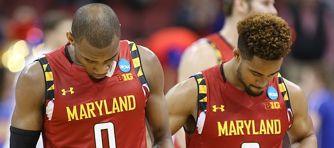 Maryland guards Rasheed Sulaimon (0) and Melo Trimble (2) make their way from the floor after their 79-63 loss to Kansas, Thursday, March 24, 2016 at KFC Yum! Center in Louisville, Kentucky.