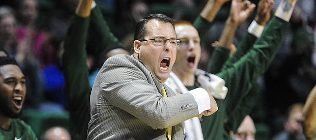 FILE - In this Jan. 9, 2016, file photo, UAB head coach Jerod Haase celebrates a basket along with his bench during the first half of an NCAA college basketball game against UTEP in Birmingham, Ala. The Blazers have one of the best records in major college basketball and a 25-game home winning streak. Still, they'll likely have to win the Conference USA Tournament to get into the NCAA Tournament via the automatic bid for a second straight season. (AP Photo/John Amis, File)