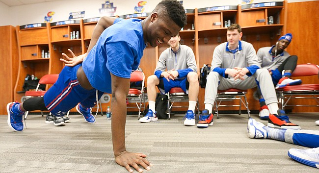 Kansas forward Carlton Bragg Jr. successfully completes a one-handed pushup in the locker room on Friday, March 25, 2016 at KFC Yum! Center in Louisville, Kentucky.