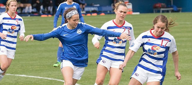 Kansas' Taylor Christie (17) and Hanna Kallmaier (23) attempt to slow down the FC Kansas City offense during their exhibition soccer match on Saturday at Rock Chalk Park.