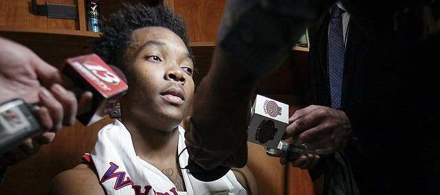 Devonte' Graham, left, and Frank Mason III, are interviewed after their 64-59 loss to the Villanova Wildcats Saturday, March 26, 2016 in an NCAA Elite Eight matchup at KFC YUM! Center in Louisville, KY. .