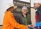Jameel Syed, right, greets Wilma Walker, of New Brunswick, N.J., left, and Barb Sneegas, of Lawrence, center, after his talk about building interfaith relationships Sunday morning at Trinity Lutheran Church, 1245 New Hampshire St. In 2015, Syed, a Muslim, became the first person to recite the adhan, or Islamic call to prayer, along with the last sermon of the Prophet Muhammad in all 50 states in only 35 days.