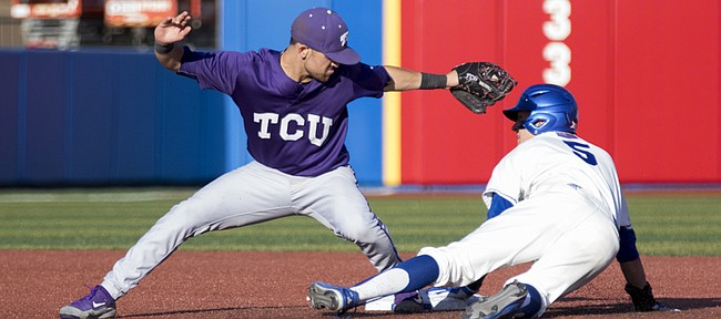 Kansas sophomore Matt McLaughlin, right, takes second base while avoiding the tag by TCU junior Ryan Merrill during their game Friday evening at Hoglund Ballpark