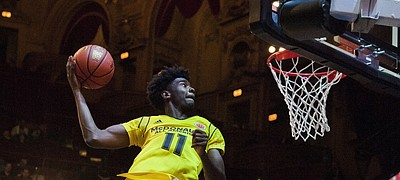 Josh Jackson, from Napa, California, competes in the slam dunk contest during the McDonald's All-American Jam Fest, Monday, March 28, 2016, in Chicago. (AP Photo/Matt Marton)