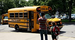 A student prepares to board a First Student bus at Quail Run Elementary School in this file photo from June 2011.