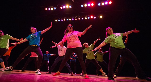 """Evolution of Dance, Broken Arrow Style"" is performed by Nicole Jones, center, and other staff and faculty from Broken Arrow Elementary School during the 24th annual Foundation Follies, April 18, 2014, at Liberty Hall."