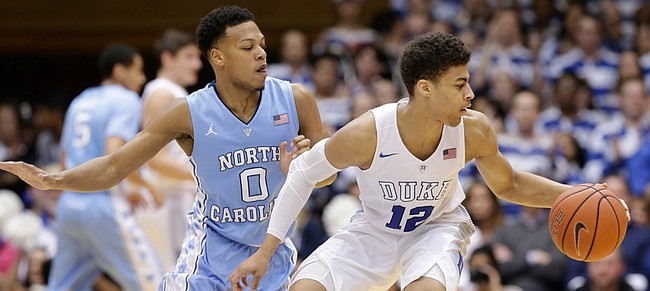 Duke's Derryck Thornton (12) is guarded by North Carolina's Nate Britt during the Tar Heels' 76-72 victory on March 5 in Durham, N.C.