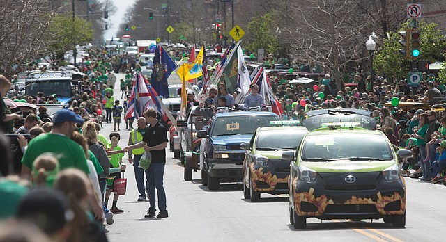 Onlookers line Massachusetts Street Thursday to catch a view of the St. Patrick's Day Parade, March 17, 2016.