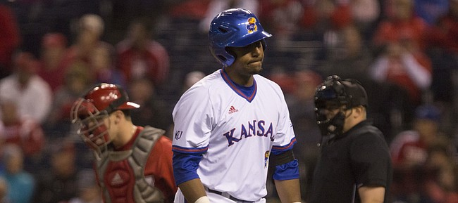 Kansas junior Marcus Wheeler reacts as he heads back to the dugout after striking out during the National College Baseball Hall of Fame Game against Nebraska Wednesday evening at Kauffman Stadium, in Kansas City, Mo. The Jayhawks fell to the Cornhuskers, 3-1.