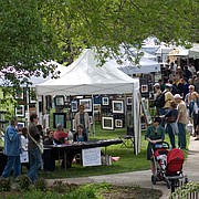 In this file photo from May 3, 2009, crowds walk past stalls displaying the work of local artists during the 48th annual Art in the Park at South Park.