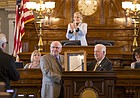 Recently-retired broadcaster Bob Davis, left of center, is honored on the floor of the Kansas House by House speaker Ray Merrick, R-Stilwell, on Thursday, April 28, 2016 at the Kansas Statehouse in Topeka. April 28, 2016 was designated as Bob Davis Day in recognition of Davis' career, most notably as the voice of Kansas Jayhawk basketball.